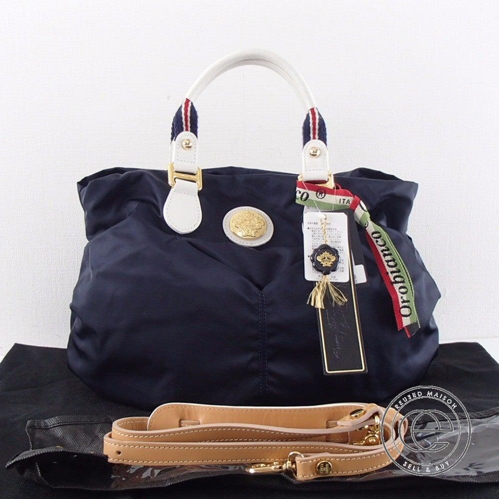 Orobianco オロビアンコ MOMOSAモモサ 2wayショルダートートバッグ ネイビー/ビアンコの買取実績です。