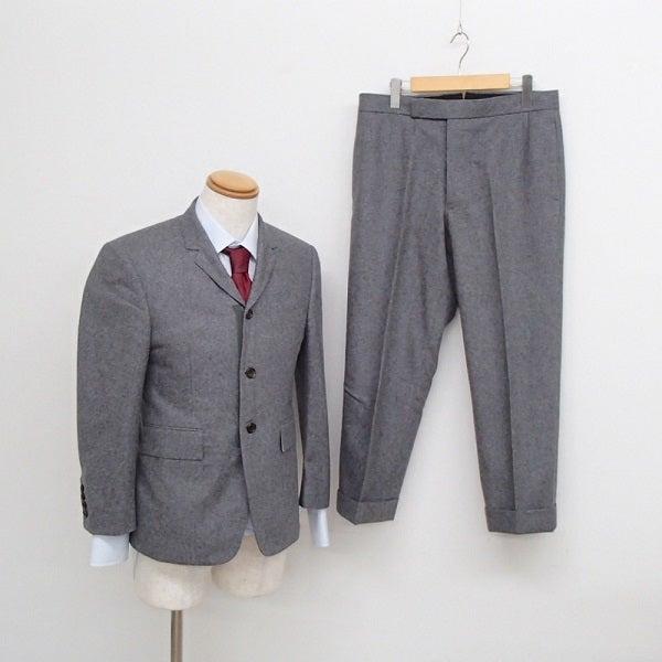 トムブラウンのMJC001CW6753 ウール3ボタン シングルスーツの買取実績です。