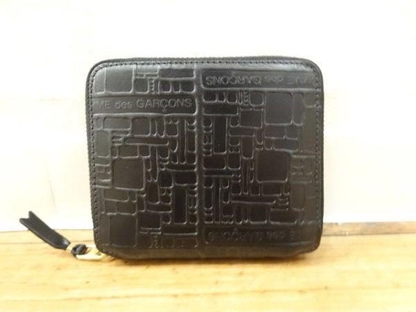 コムデギャルソンの黒 SA2100EL 二つ折り財布の買取実績です。