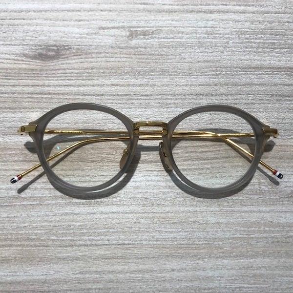 トムブラウンのTB-011-G GRY 46☐21-150 グレイゴールド 眼鏡 *度入りの買取実績です。